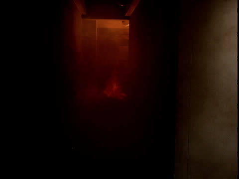 Fire spreads to a hallway.