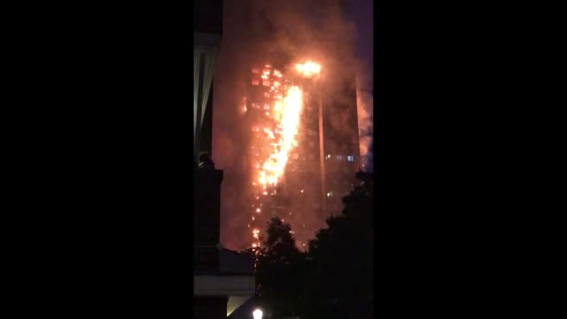 Fire still burns and smoke rises from the building after a huge fire engulfed the 24 storey residential Grenfell Tower block in Latimer Road West...