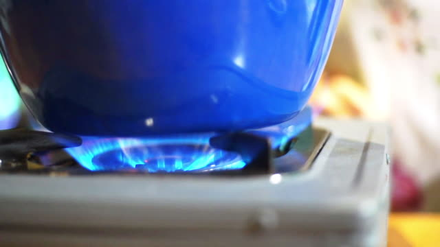 fire stove with blue pot - flammable stock videos & royalty-free footage
