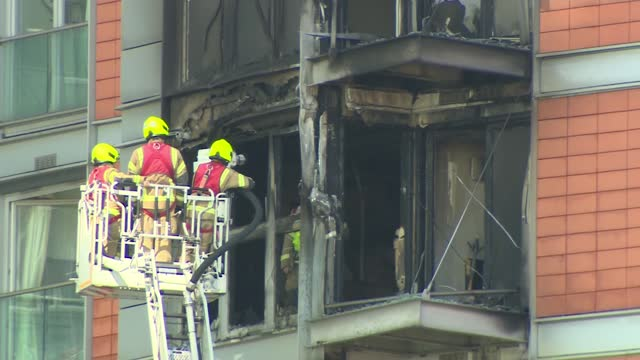 fire strikes high-rise tower in london with similar cladding to grenfell tower; england: london: ext wide shot showing fire damaged flats emergency... - itv london tonight stock videos & royalty-free footage