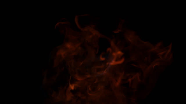 SLO MO of fire tongues emerging from black background