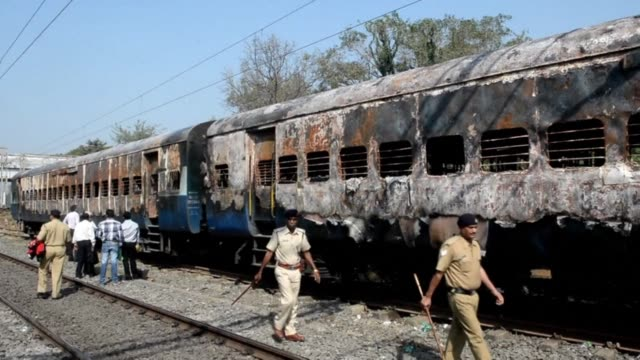 fire tore through an indian train full of sleeping passengers killing nine people and forcing survivors to break open doors to escape officials and a... - witness stock videos & royalty-free footage