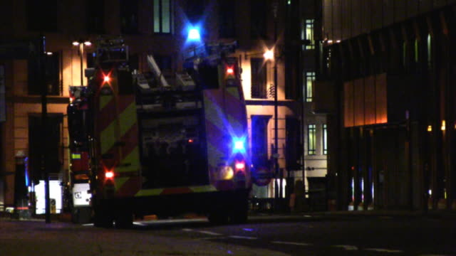 fire truck at night, city of london, lights blinking (hd) - fire engine stock videos & royalty-free footage