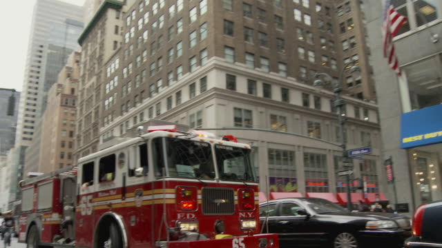 ms fire truck driving on busy street / new york city, new york, usa - fire engine stock videos & royalty-free footage