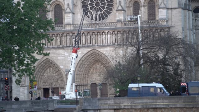 fire truck is seen next to notre dame cathedral on april 18, 2019 in paris, france. fire broke out in notre dame cathedral on the evening of monday... - notre dame de paris stock videos & royalty-free footage