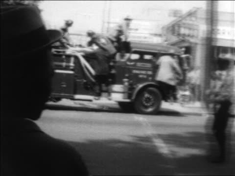 vídeos de stock, filmes e b-roll de pan fire truck on street heading to civil rights demonstration / alabama / newsreel - 1963