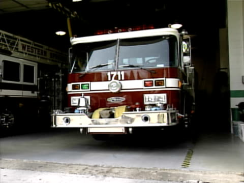 fire trucks and ambulances at western springs fire department in illinois on august 1 2002 - fire station stock videos & royalty-free footage
