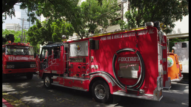 fire trucks at the manila peninsula hotel, makati - fire engine stock videos & royalty-free footage
