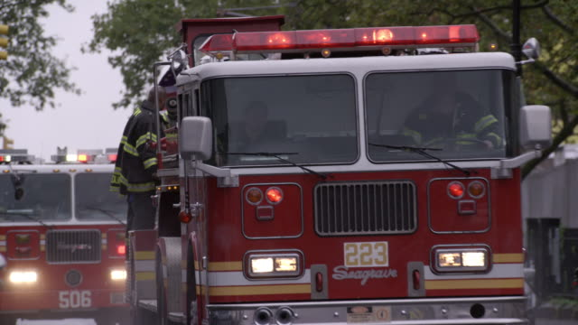 ms, cu, fire trucks driving on street, new york city, new york, usa - 消防車点の映像素材/bロール