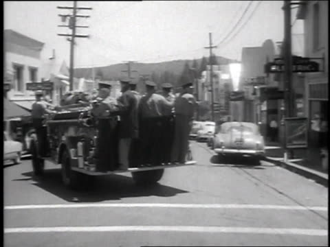 1951 montage fire trucks head to annual water fight / nevada city, california, united states - water fight stock videos & royalty-free footage
