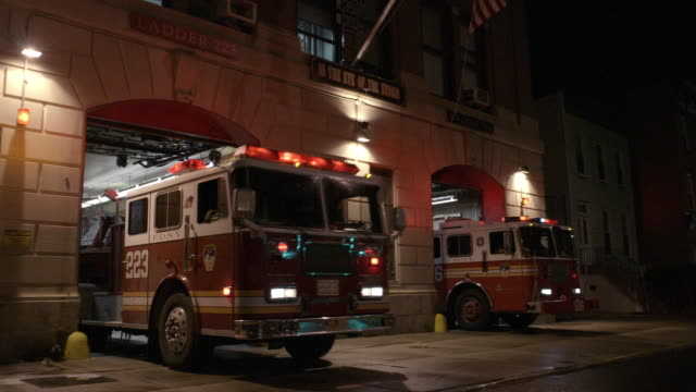 cu, cs, ws, fire trucks leaving station and driving on street at night, brooklyn, new york city, new york, usa - fire station stock videos & royalty-free footage