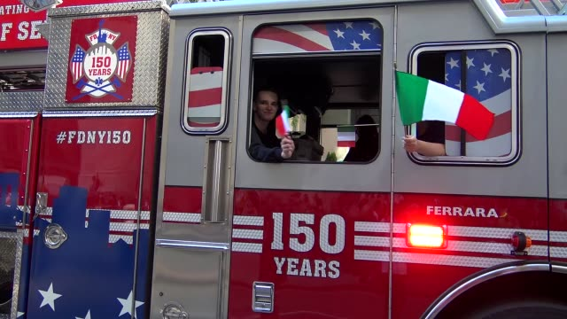 fire trucks of the fdny march during the columbus day parade on 5th avenue midtown manhattan new york city usa - fire department of the city of new york stock-videos und b-roll-filmmaterial