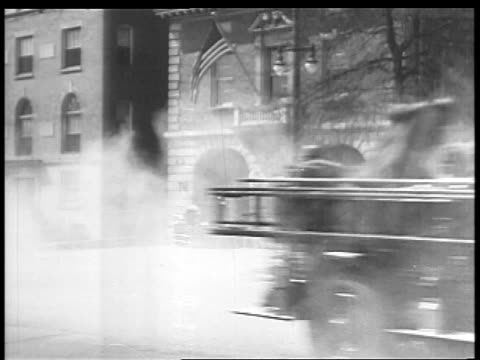 b/w 1927 fire trucks passing stationhouse quickly / educational - 1927 stock videos & royalty-free footage