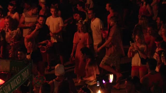 fire twirlers perform during the full moon party on the beach on ko phangan in thailand on jan 4 2015 - ko phangan stock videos and b-roll footage