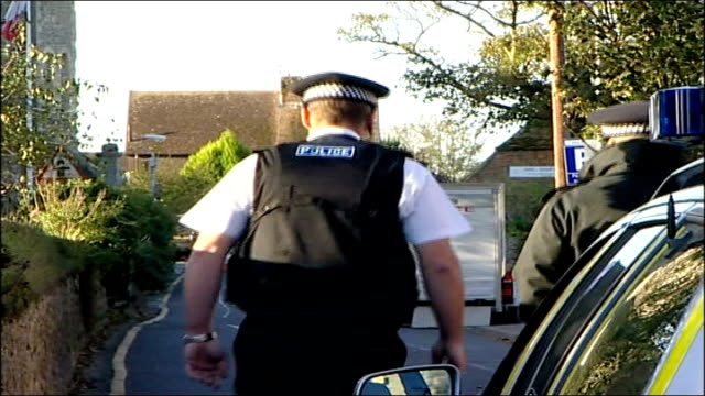 firearms officer involved in de menezes shooting kills armed robbery suspect; police officers along road close to area of suspected robbery police... - road closed sign stock videos & royalty-free footage
