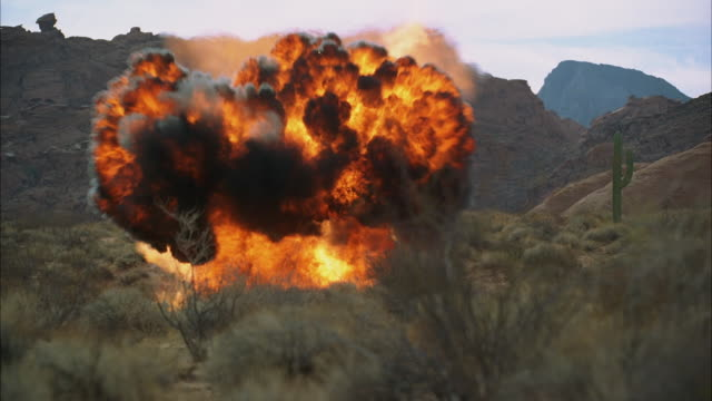 ws fireball explosion in desert - fireball stock videos & royalty-free footage