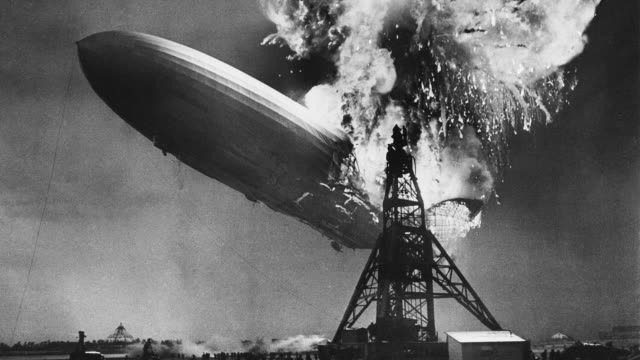 A fireball fills the sky above the Hindenburg airship at Naval Air Engineering Station Lakehurst in New Jersey.