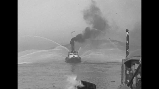 VS fireboat demonstration with hoses pumping in San Francisco Bay seagulls appear fly away / Note exact month/day not known