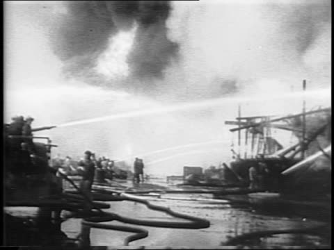 fireboats shoot water onto fires / montage of firemen shooting water at the blaze / rubble on dock after fire is put out - henry j. kaiser stock videos and b-roll footage