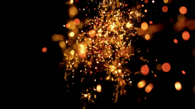 slo mo firecracker sparkles on black background - sparks stock videos & royalty-free footage
