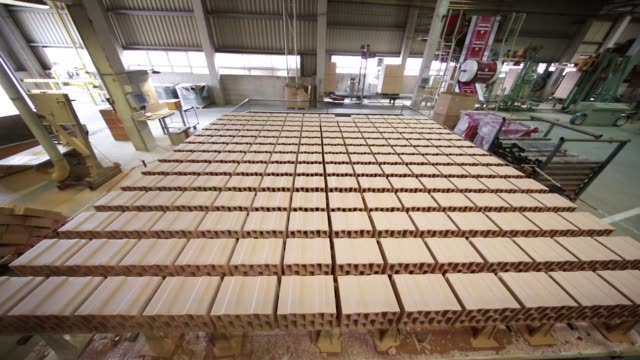 fired clay bricks sit on a kiln car at the wienerberger ag brickmaking plant in haiding austria on monday aug 28 photographer lisi niesner - traditionally austrian stock videos & royalty-free footage