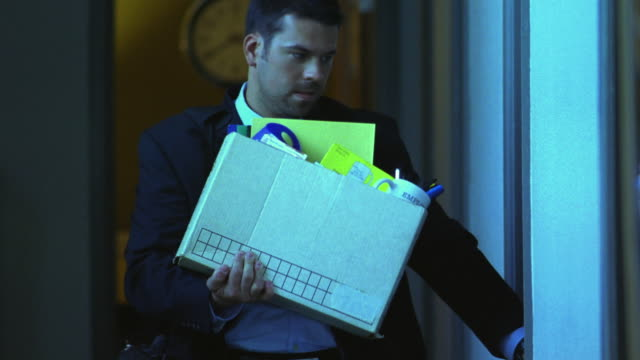 CU, Fired office worker carrying box of office items, Dallas, Texas, USA