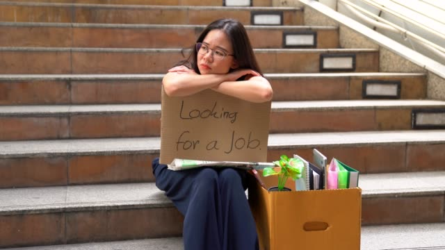fired office worker women begging for a job sitting with homeless begging for help on the street.the economic crisis, economic reform concept.white collar employee being fired her sitting on the sidewalk to begging a new job. - job centre stock videos & royalty-free footage