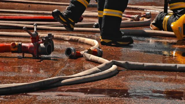 slo mo brandman efter komplett jobb - lydnad bildbanksvideor och videomaterial från bakom kulisserna