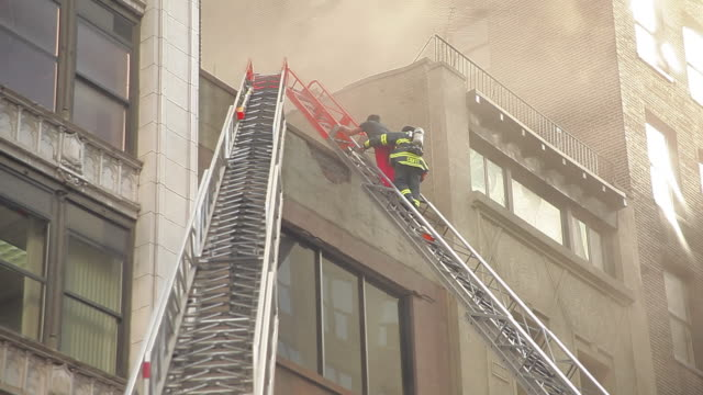 firefighter and apartment fire in new york city - ladder stock videos and b-roll footage