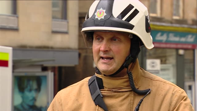 firefighter david young talking about efforts to extinguish the fire at the glasgow school of art - charles rennie mackintosh stock videos and b-roll footage