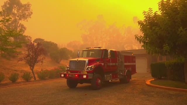 firefighter leaves a firetruck in mendocino county, california on august 1, 2018. - fire engine stock videos & royalty-free footage