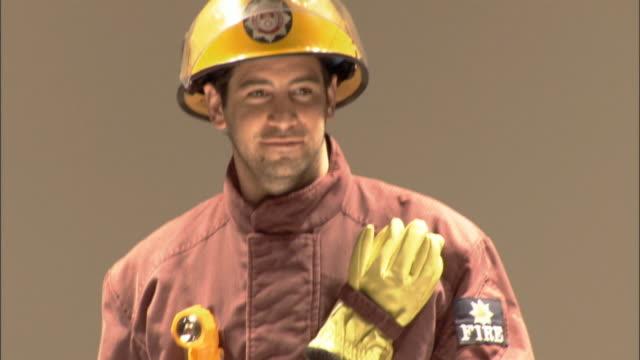 vídeos y material grabado en eventos de stock de ms firefighter modeling on catwalk / london, england, uk - héroes