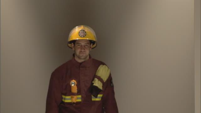 MS Firefighter modeling on catwalk / London, England, UK