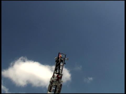 Firefighter on Rising Ladder
