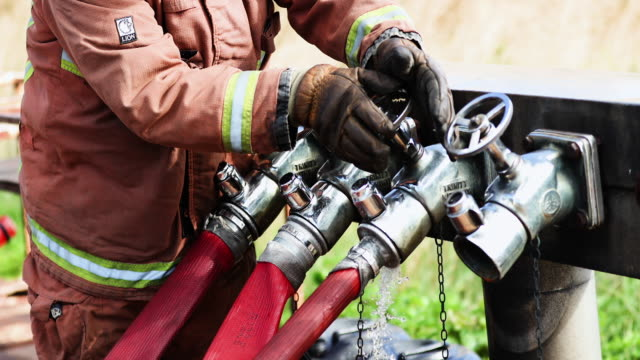 firefighter opening valves - darlington north east england stock videos & royalty-free footage