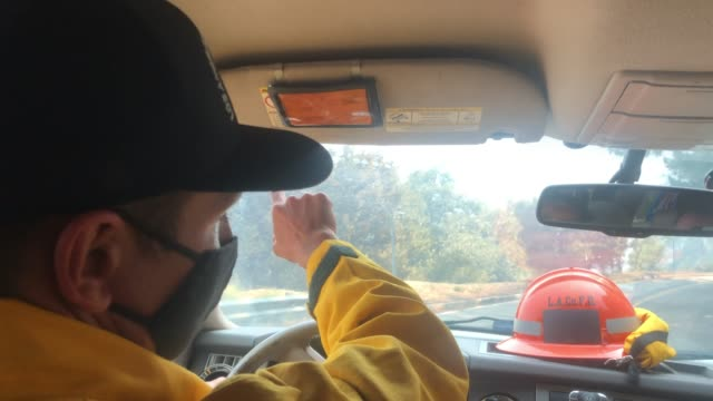 firefighter pio drives while escorting media during the bobcat fire in the angeles national forest on september 23 near pasadena, california. the... - pasadena california stock videos & royalty-free footage