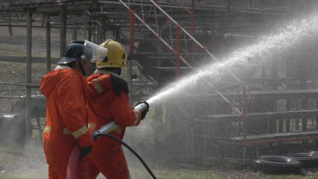 firefighter practice at field slow motion - emergencies and disasters stock videos & royalty-free footage