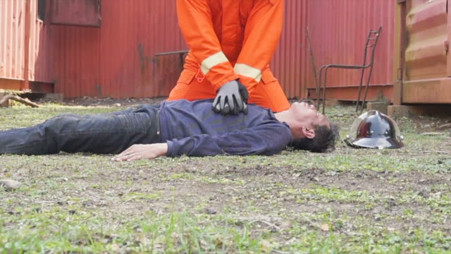 firefighter practice  do cpr outdoor slow motion - cpr stock videos & royalty-free footage