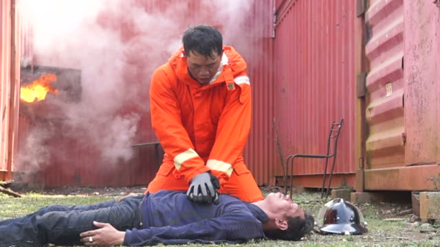 Firefighter Practice Do CPR Outdoor Slow Motion
