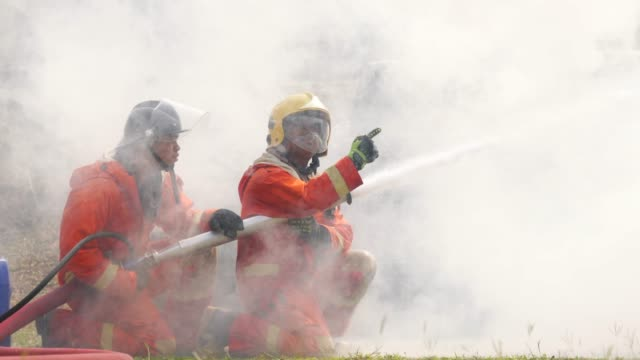 firefighter practice in smoke - firefighter stock videos and b-roll footage