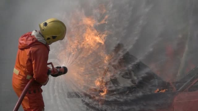 firefighter practice slow motion - risk stock videos and b-roll footage
