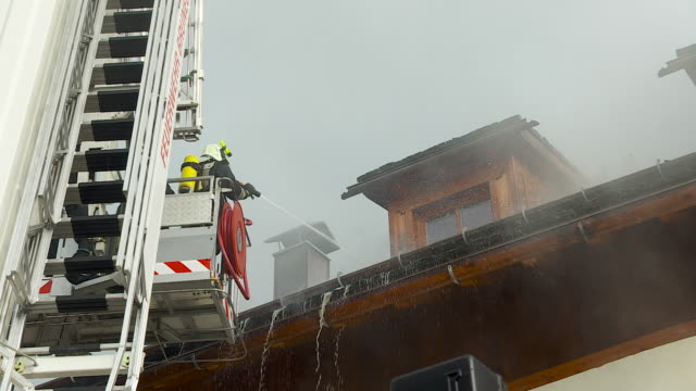 Firefighter rises to house roof, GoPro, Camera Movement, Handheld Camera,
