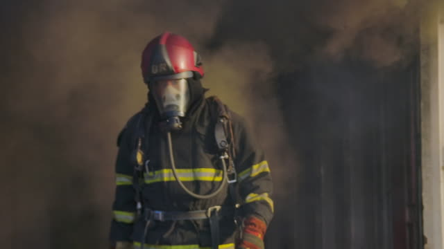 firefighter - fire hose stock videos & royalty-free footage