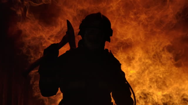 vídeos de stock e filmes b-roll de firefighter working. fire is raging. in slow motion. - fogo