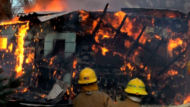 firefighters and burning house with falling debris. - ruined stock videos & royalty-free footage