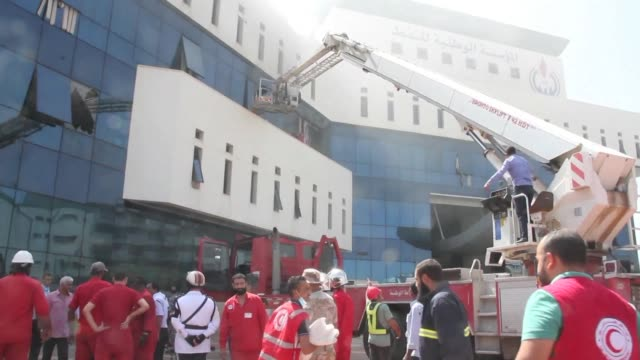 firefighters and emergency services gather in front of the headquarters of libya's national oil company in the capital tripoli following an attack - libya stock videos & royalty-free footage