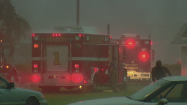 MS, Firefighters and emergency vehicles on-site during torrential downpour, Woodbine, Georgia, USA