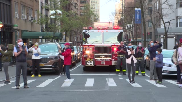 firefighters and neighbors cheered for healthcare workers who risk their lives to serve for new type of coronavirus patients in new york city, united... - firefighter stock videos & royalty-free footage
