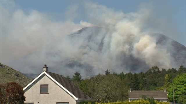 Firefighters are battling a string of gorse blazes in the Mourne Mountains in Northern Ireland Large areas of mountain range have been burnt out in...