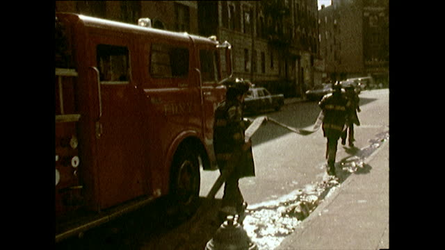 firefighters arrive at a fire in the bronx; 1972 - 1972 stock videos & royalty-free footage